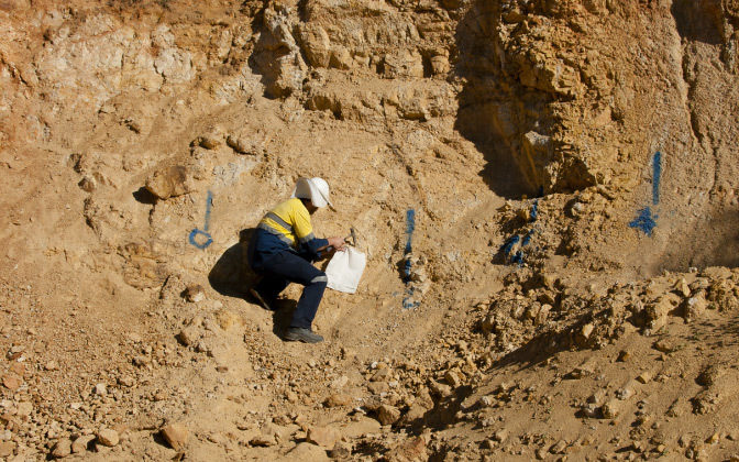Geologist Sampling Open Cut Mine